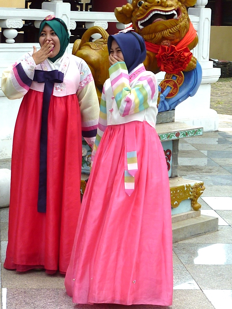 Indonesian Muslim women wearing Korean  hanbok  dresses for a photo in the courtyard of the Sam Poo Kong temple. Photo by Paul Marshall.