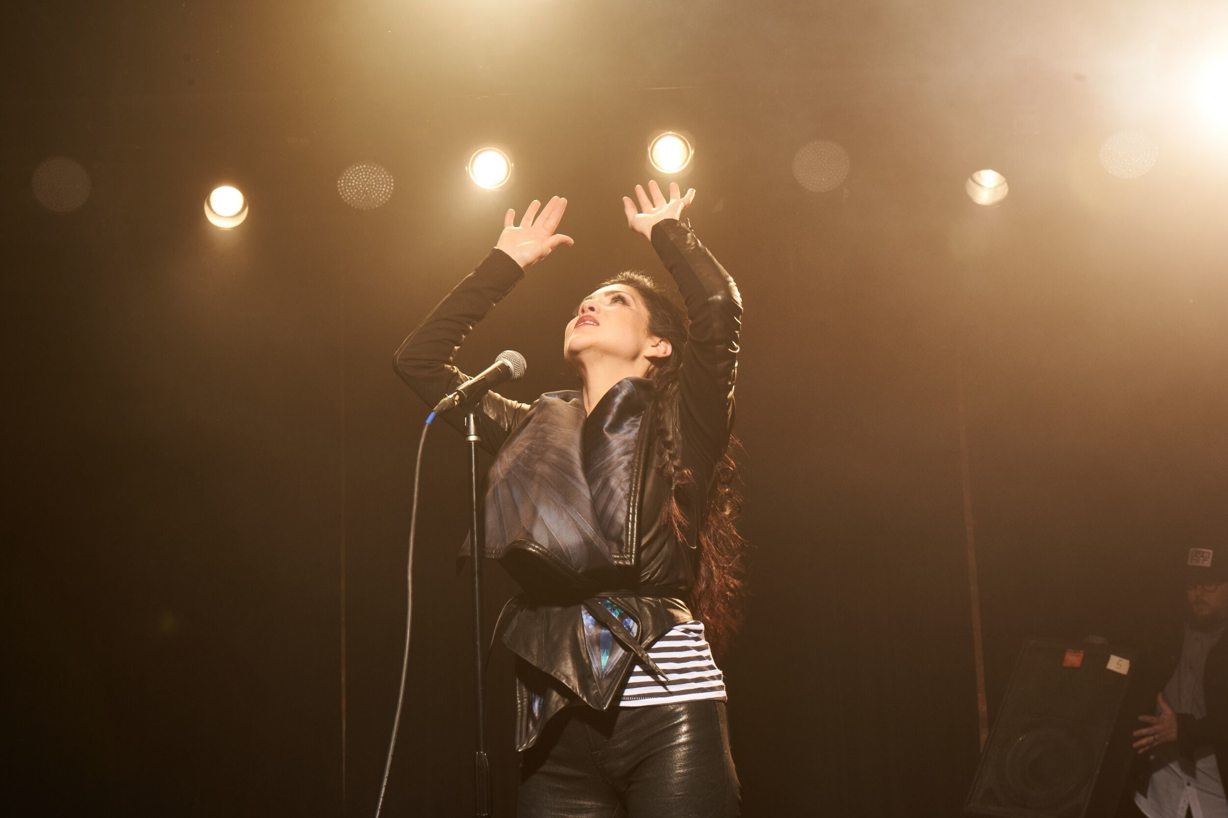 Jaci Velasquez performing at a concert. Photo by Allen Clark.