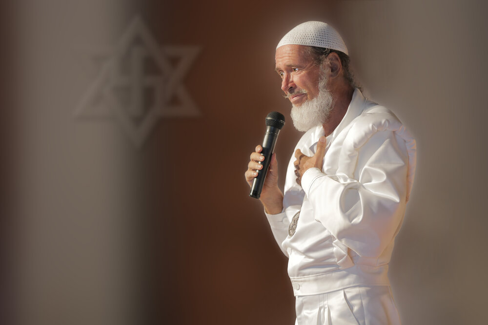 Rael, the Raelians' leader, speaking at a Raelian Asia seminar on the 45th anniversary of his revelations in 1975. Photo courtesy of the International Raelian Movement.