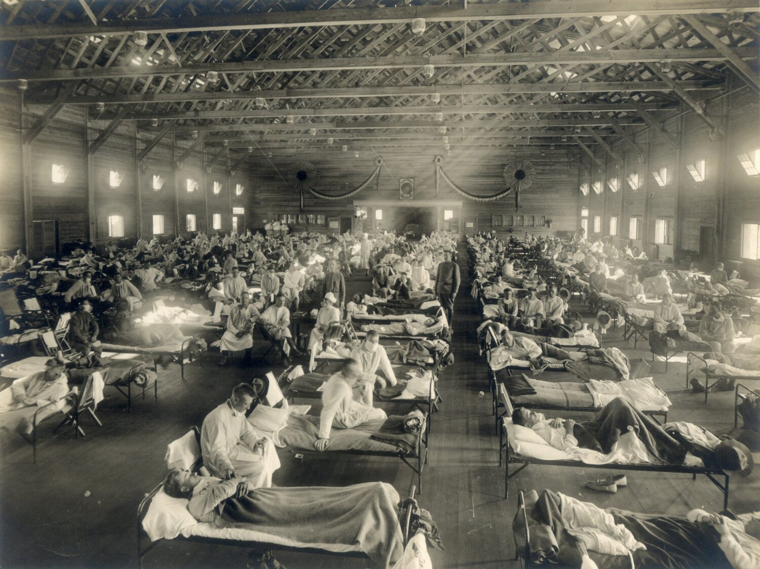 "Emergency hospitals, including this one at Camp Funston, Kan., arose during the 1918 ""Spanish flu"" pandemic, which killed about 50 million people globally. Photo via Wikimedia Commons"