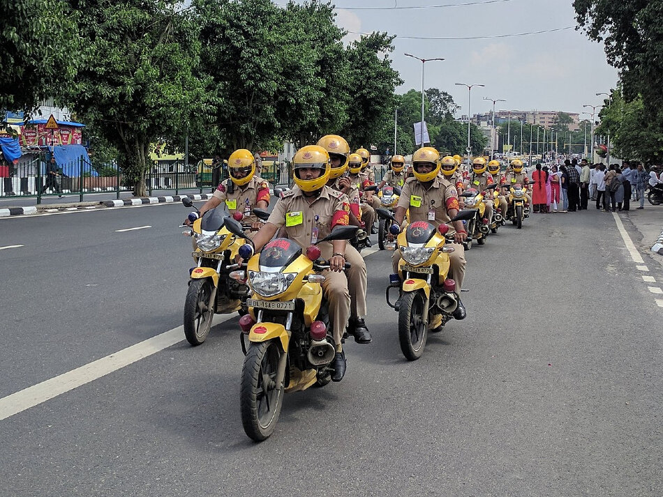 Delhi Police on patrol during a funeral procession in August 2018. Creative Commons photo.