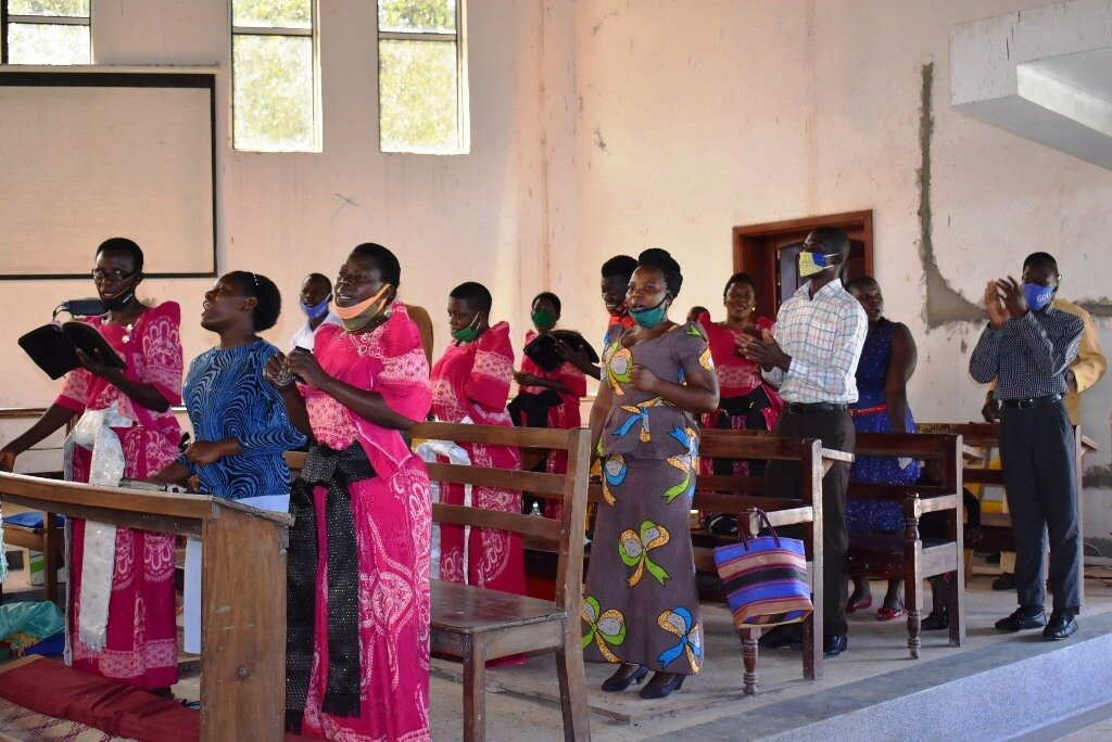 The choir at St. Mark's Church of Uganda sang hymns for the congregation at the church's first reopening since the COVID-19 lockdown. Photo by John Semakula.