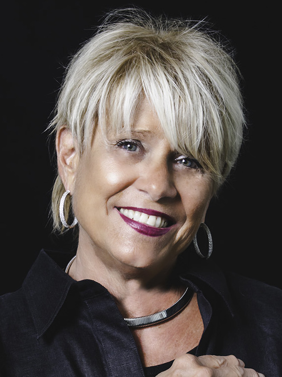 "Arlene has owned and operated Imagine Salon for 25 years, but her passion for the  fashion arts started at a very young age. Inspired by her mother, a premiere colorist, she was always focused on hair for her creativity, and her sculpting abilities evolved into the beauty business. Making someone feel beautiful inwardly and outwardly is her greatest reward. Arlene truly loves what she does. A one word description of Arlene's work is ""edgy."" Attending the number one advanced education programs of Vidal Sassoon, Paul Mitchell, Jacques Dessange and Bumble and Bumble have paved the way to her success. Specializing in texturizing and shaping hair to create natural movement for easy maintenance and care is her mantra. She was a pioneer in introducing the keratin treatment and prides herself with being on the cutting edge in fashion and hair design."