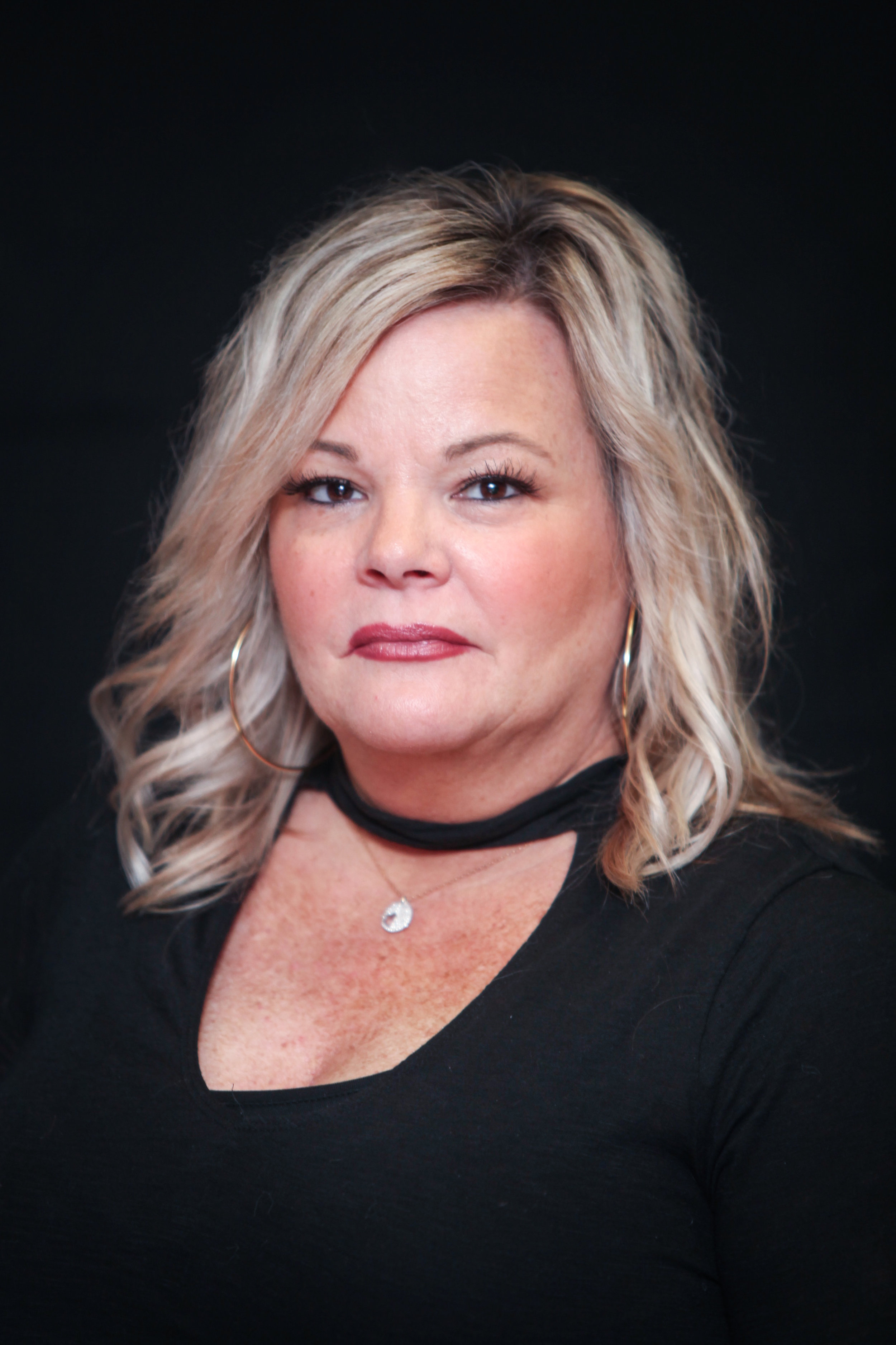 "Trained at the renown Brocato International, Debra , with over 28 years of experience in the beauty industry, recently has joined our expanding team of professionals. Because of her expertise and charm, she gets great satisfaction from making sure that every person who sits in her chair feels amazing about him or herself. In the ever changing field of hair, she educates herself to master new color and hair techniques. Debbie is an expert in ""tape-in hair extensions. "" Being certified and having years of practice, she has learned the art of quick and perfectly seamless extensions. In addition to hair extensions, Debbie has become skilled at Keratin treatments, corrective color, highlights, men and women's haircuts using advanced techniques, such as balayage and ombres, She takes the time to understand her client's personality and lifestyle to create the best look for each individual client. With her mastery skills and knowledge, she will make all her clients beautiful, confident, and dazzling!"