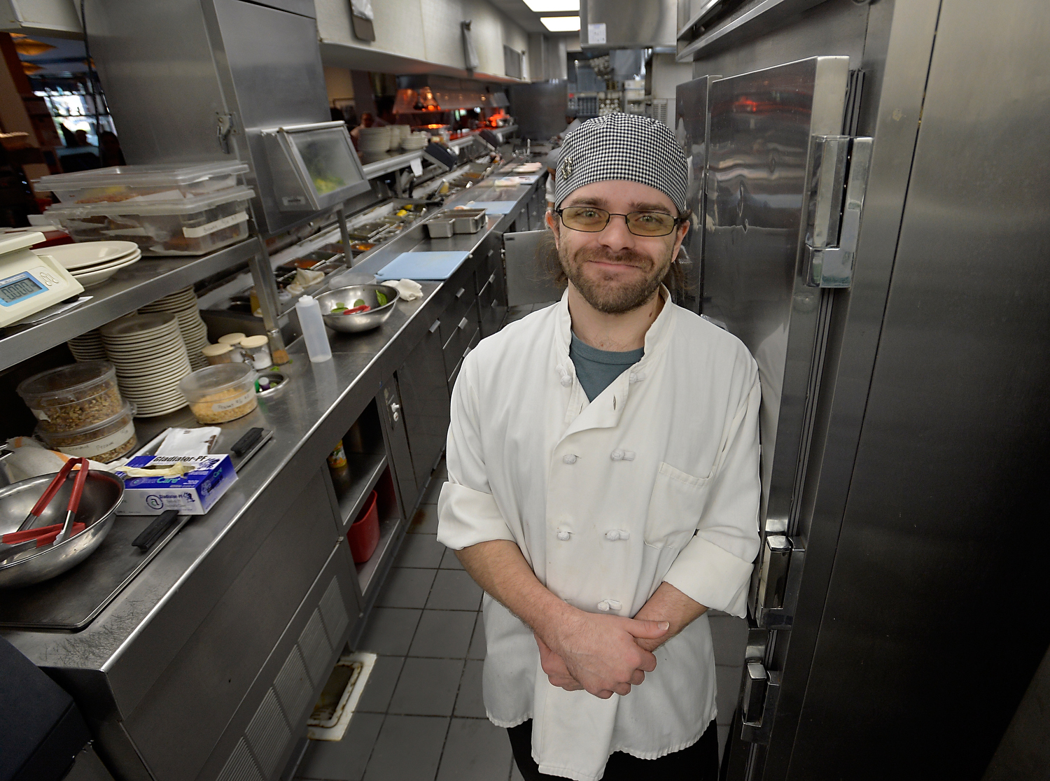 Garrick Knight, 27 of Cary, N.C., is a prep-cook at Local 32 in Cary, N.C. on Thursday, December 15, 2016. Knight is a graduate of the Inter-faith Food Shuttle's culinary school. (Photo by Sara D. Davis)