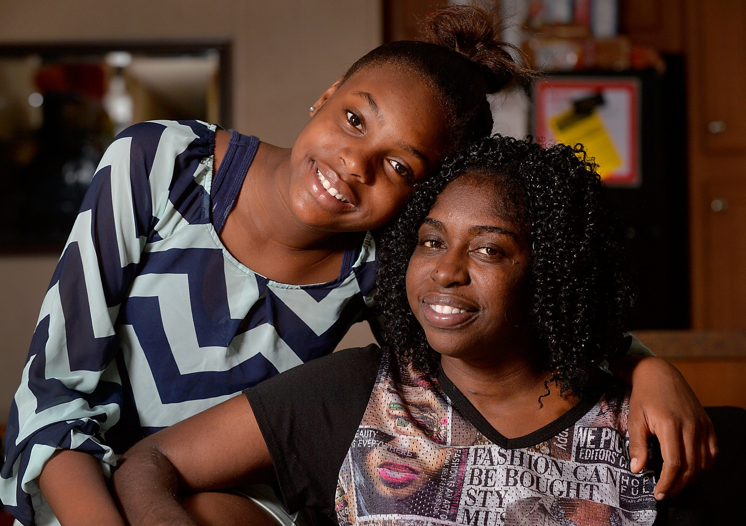 Lateisha Sallah and her daughter Jasmine, 11, in their home in Raleigh, N.C., on Thursday, June 16, 2016. During a health crisis that led to job loss and homelessness, Lateisha's daughter was able to receive the IFFS BackPack Buddies program. IFFS, together with other nonprofits, came together to support her while she got back on her feet.(Photo by Sara D. Davis)