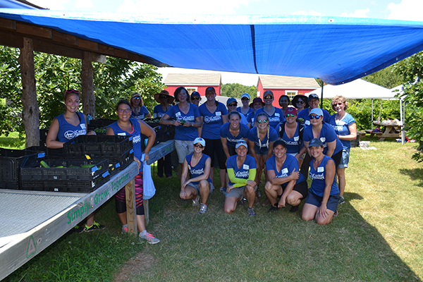 The Capitol Women's Network volunteer group for the morning of service at the Inter-Faith Food Shuttle Teaching Farm AFTER finishing their work on Thursday, July 13, 2017.