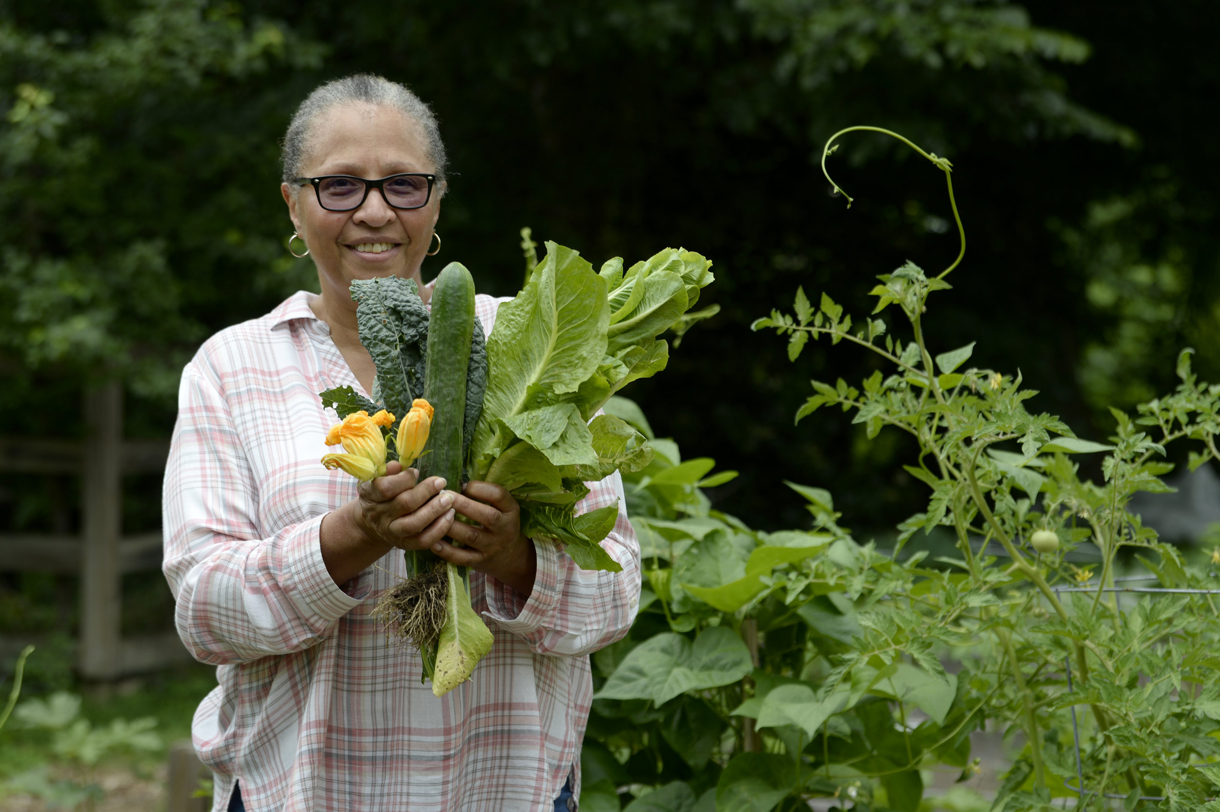 Barbara in the garden with her most recent harvest.