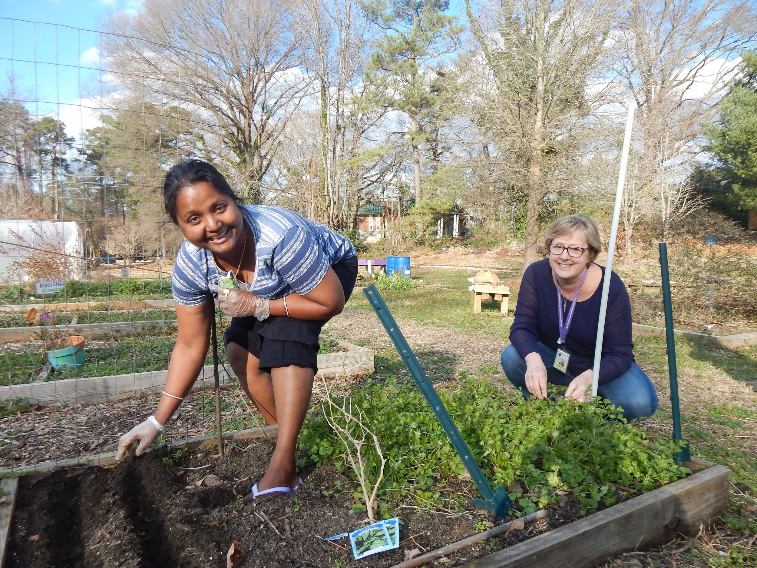 One of Alliance Medical Ministry's Community Gardners Bithika, pictured with their Nursing Director, Kim. She and her husband are starting their second year of gardening at Alliance, their favorites to grow are cilantro, tomatoes, and mustard.