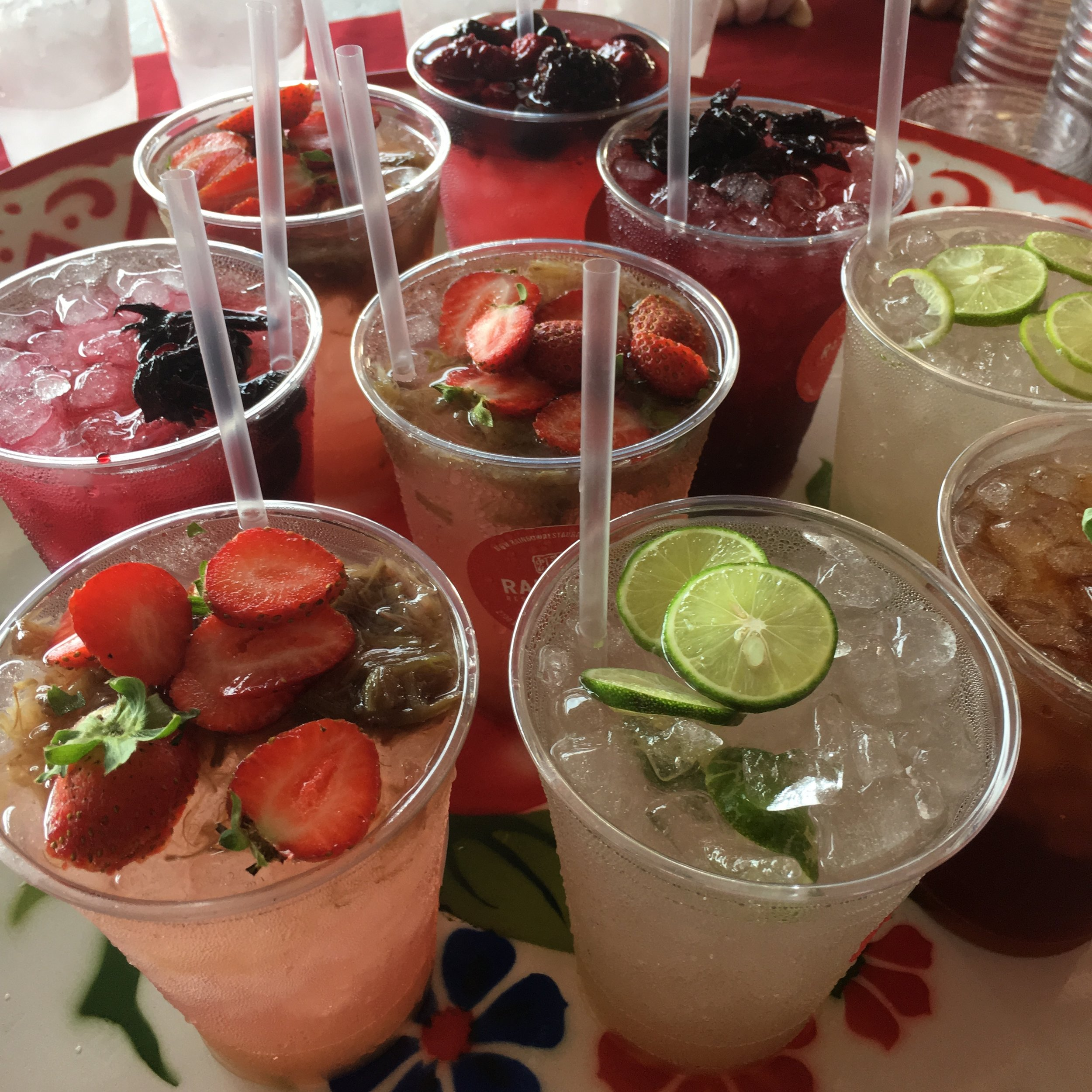 Freshly made herbaceous coolers: lime/lemongrass, hibiscus, strawberry and more