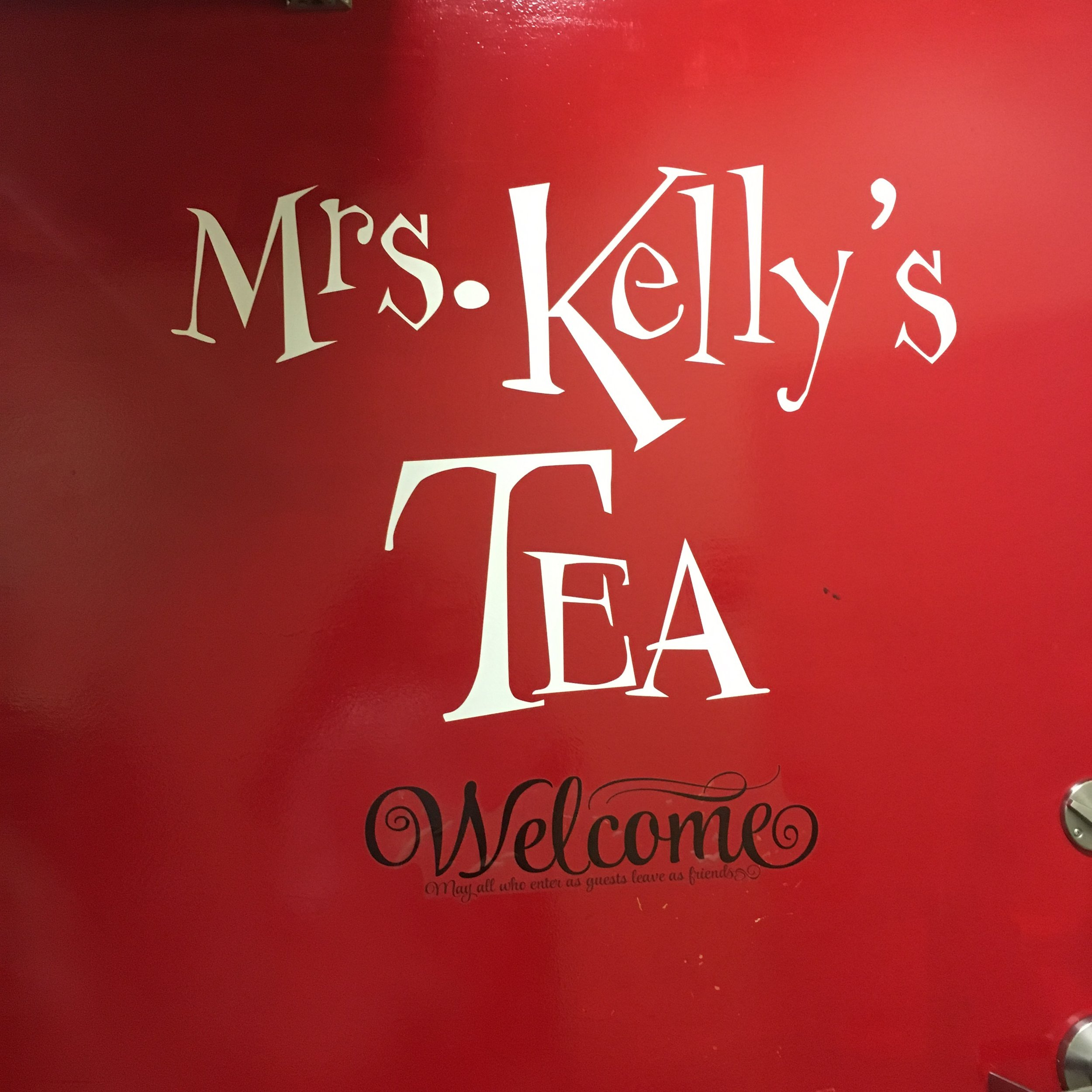 Bold red sign welcomes you to Mrs. Kelly's Tea in Northeast Minneapolis