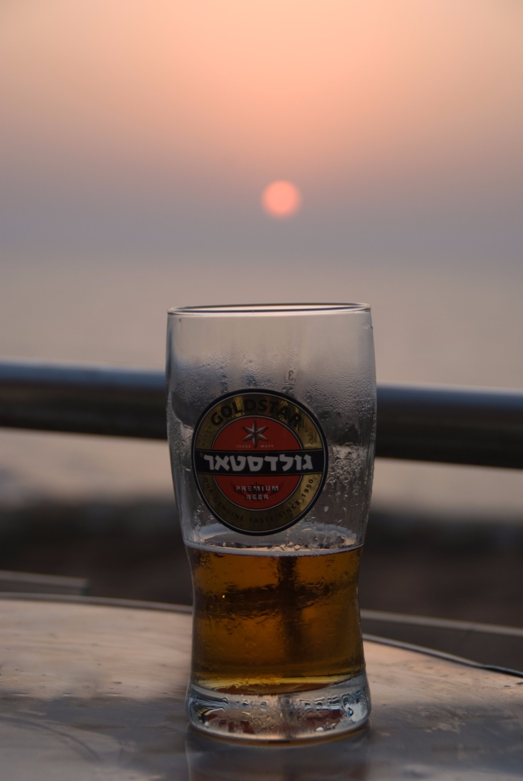 The old golden standard of Israeli beer - Goldstar, enjoyed at the Mediterranean sunset