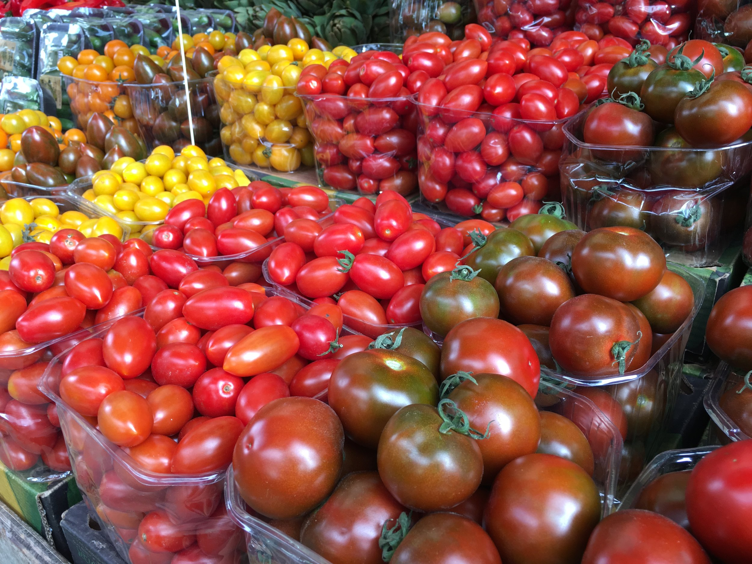 Glistening tomatoes at the market