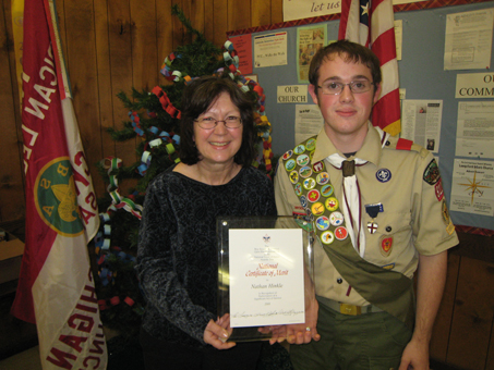 Suzanne Gordon, left, found herself trapped in a flooding car after an accident on County Road D-19 last February until Nathan Hinkle, right, came along to help. Hinkle has received a national certificate of merit from the Boy Scouts of America. (PHOTO COURTESY, PINCKNEY BOY SCOUT TROOP NO. 312)