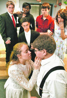 "The Kensington Woods High School drama club presents ""Prelude to a Kiss."" Front left: Abbi Hittel as Rita, Brad DiGiamberardino as The Old Man. Center: Nick German as Peter. Back left: Josh McGahey as Uncle Fred, Erica Phillips as Aunt Dorothy, Jimmy Valentine as Dr. Marshall Boyle and Eryca Cottle as Mrs. Boyle. (Photo by ALAN WARD/DAILY PRESS & ARGUS)"