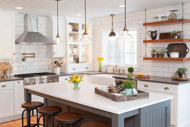 Farmhouse-style-kitchen.-Modern-Farmhouse-style-kitchen.-Farmhouse-style-kitchen-with-retro-lighting-reclaimed-wood-open-shelves-grey-island-white-perimeter-cabinets-and-brick-style-subway-tiles..jpg
