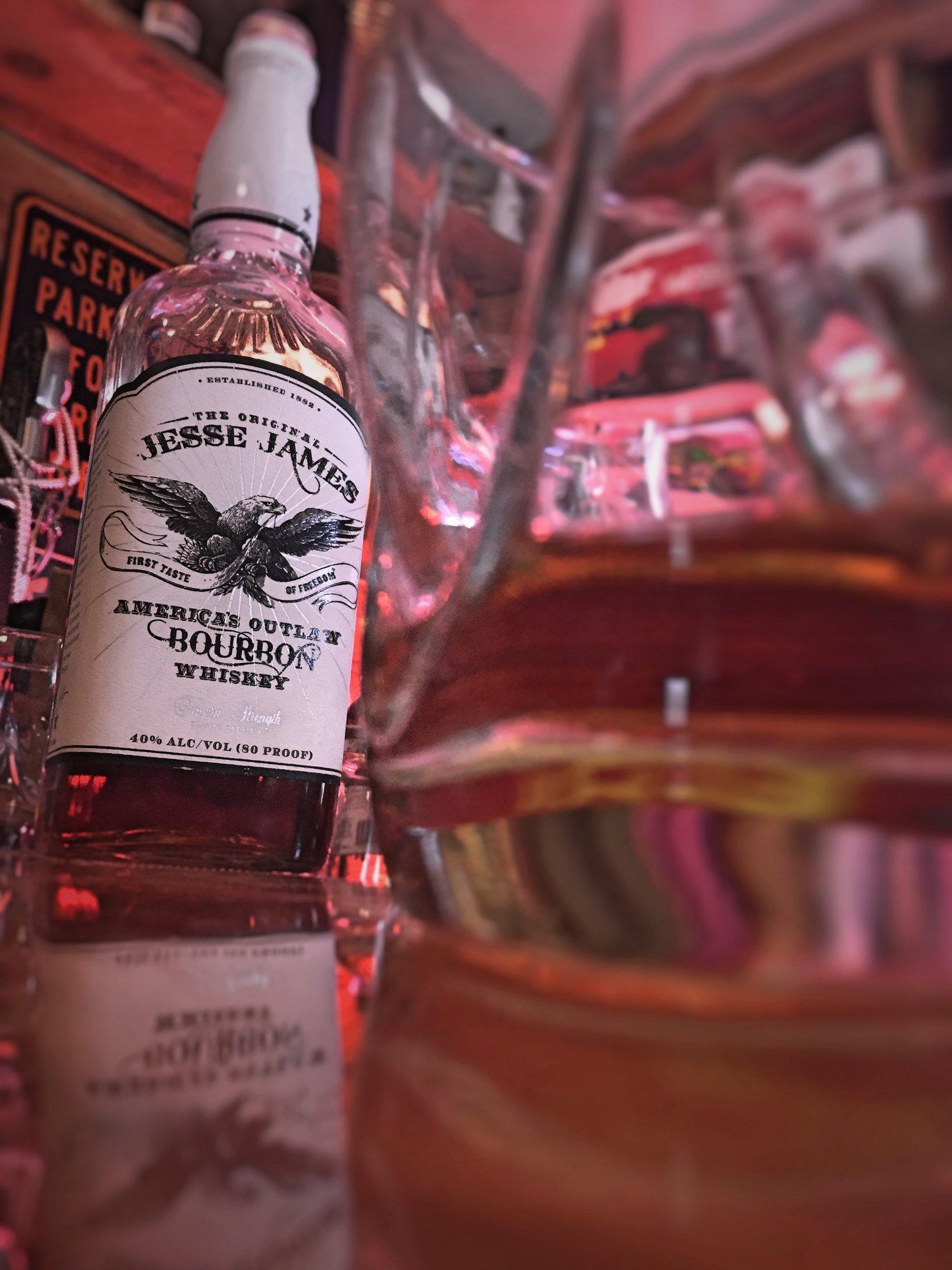 JJB+with+glass+on+bar.jpg