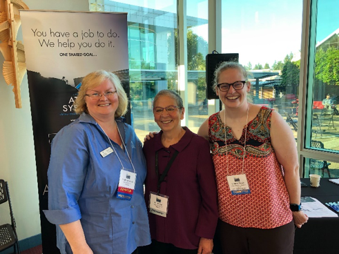 Pictured left to right: Stephanie Spires of Atlas Systems, NWILL Keynote Speaker Nancy Pearl, and Summer Steele of Oregon Health and Science University.