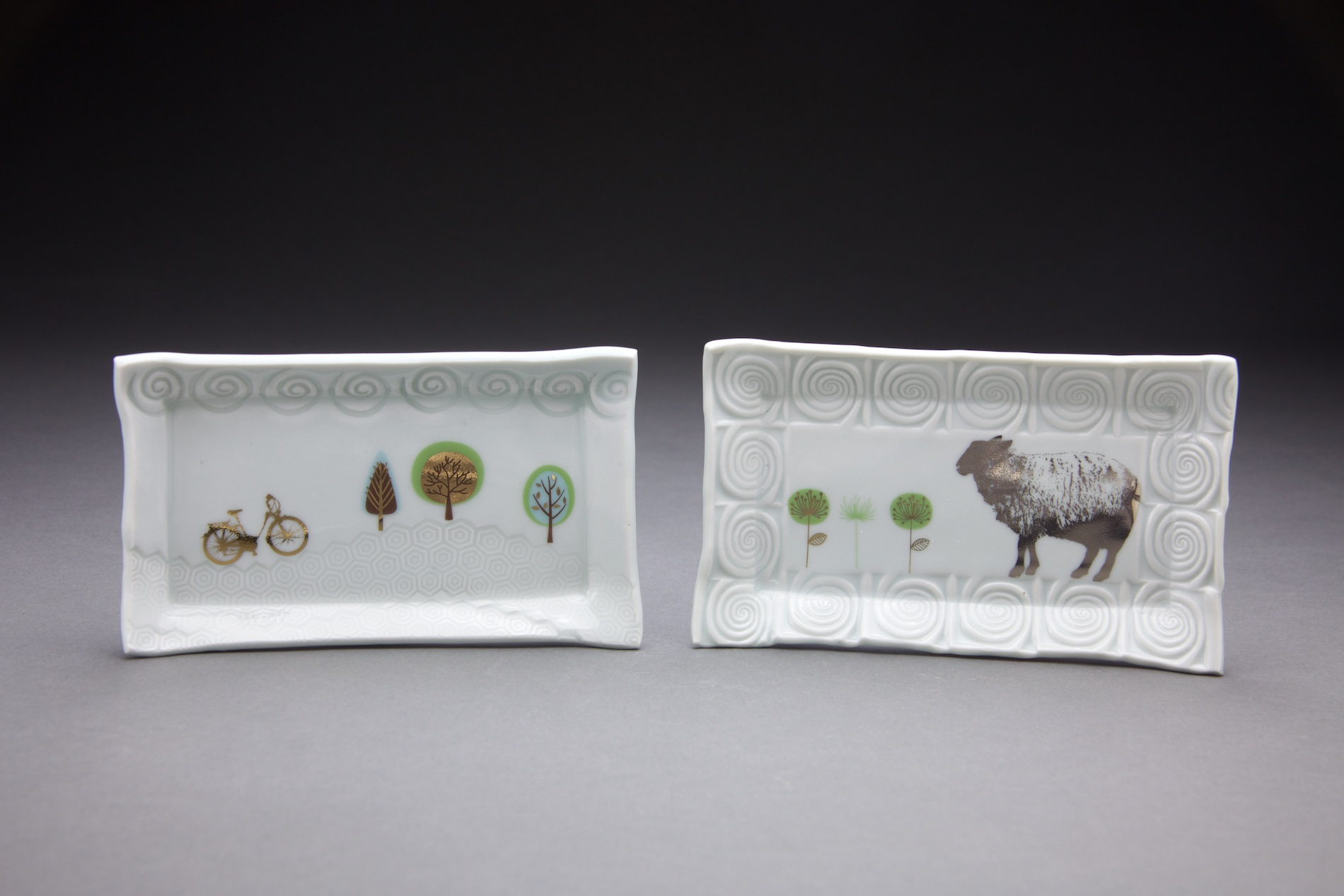 Each tray is 3x6in.clear glaze with gold & platinum decals.