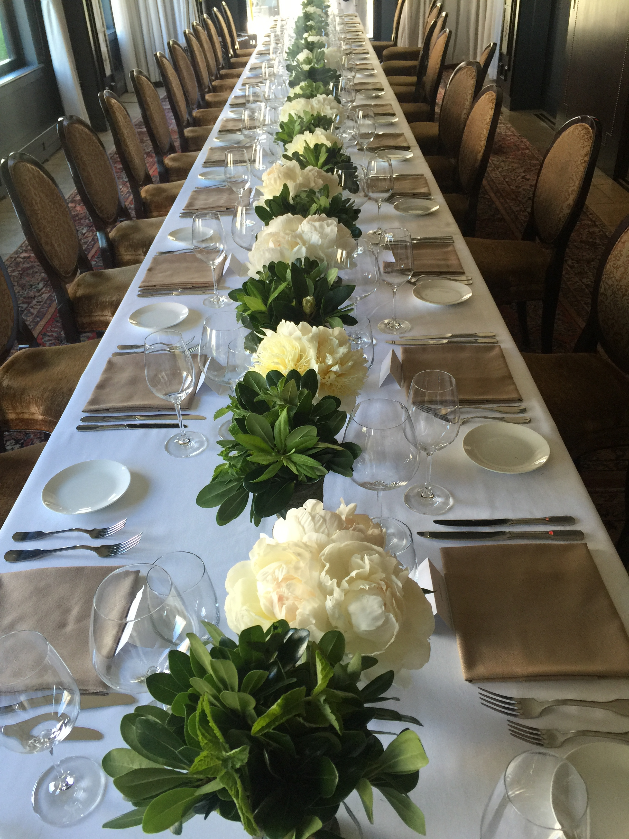 One long table of peony and green at the The Nomad Hotel