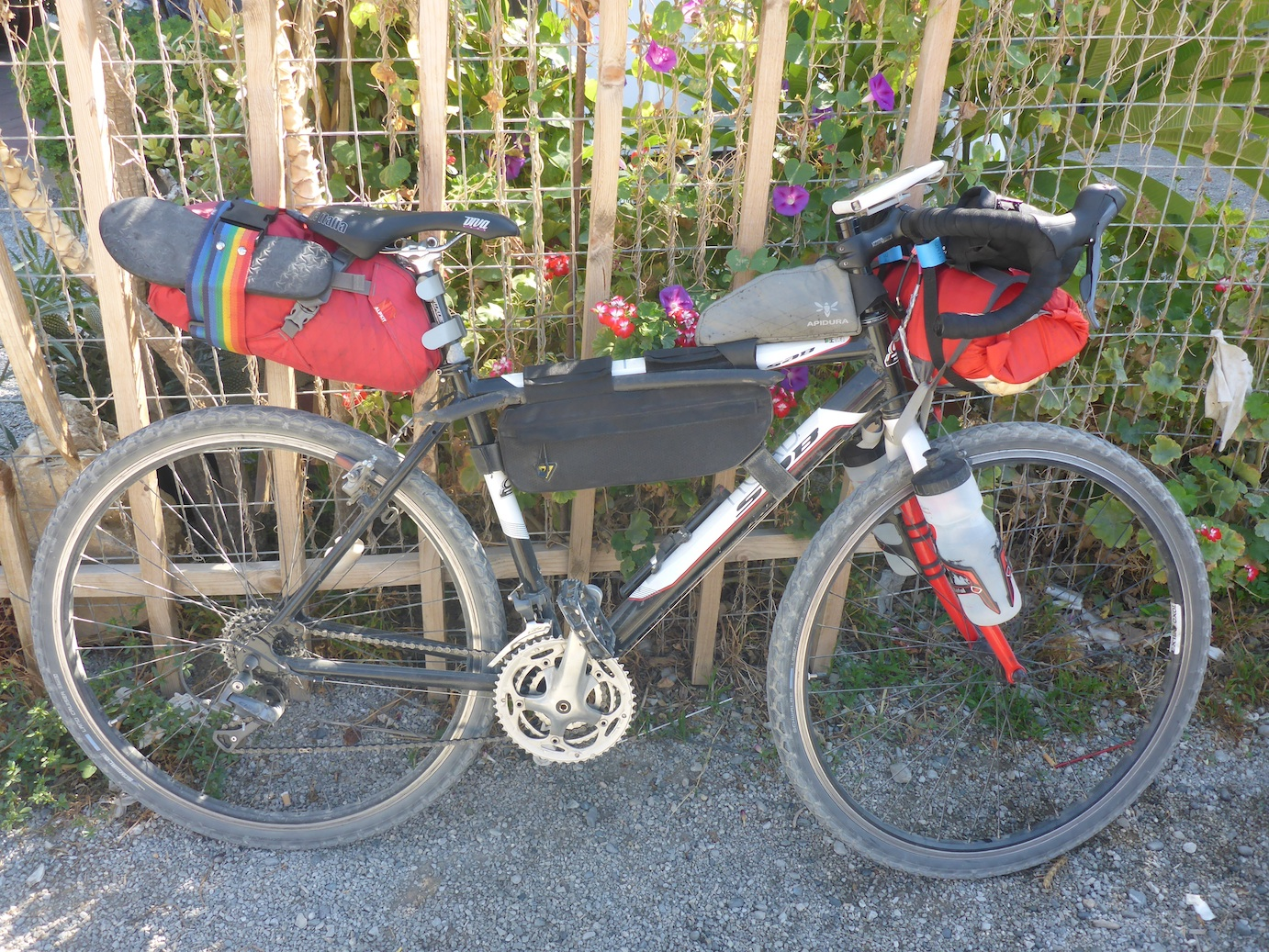 My bike, fully loaded. Note: plastic pipe, psychological deterrent for angry loose farm dogs… (thankfully never needed!)