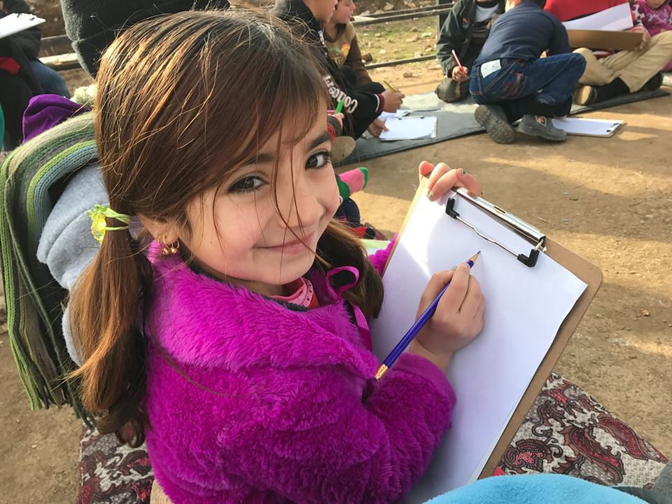 Zhiyan, who has never been to formal school, loves learning and raising her hand, even if she doesn't know the answer!