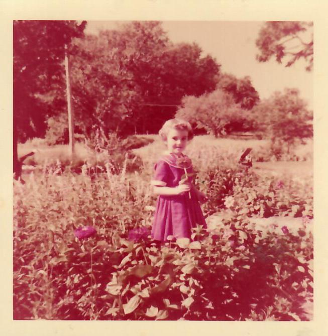 Here I am in my Betsy McCall dress in Mom's garden.