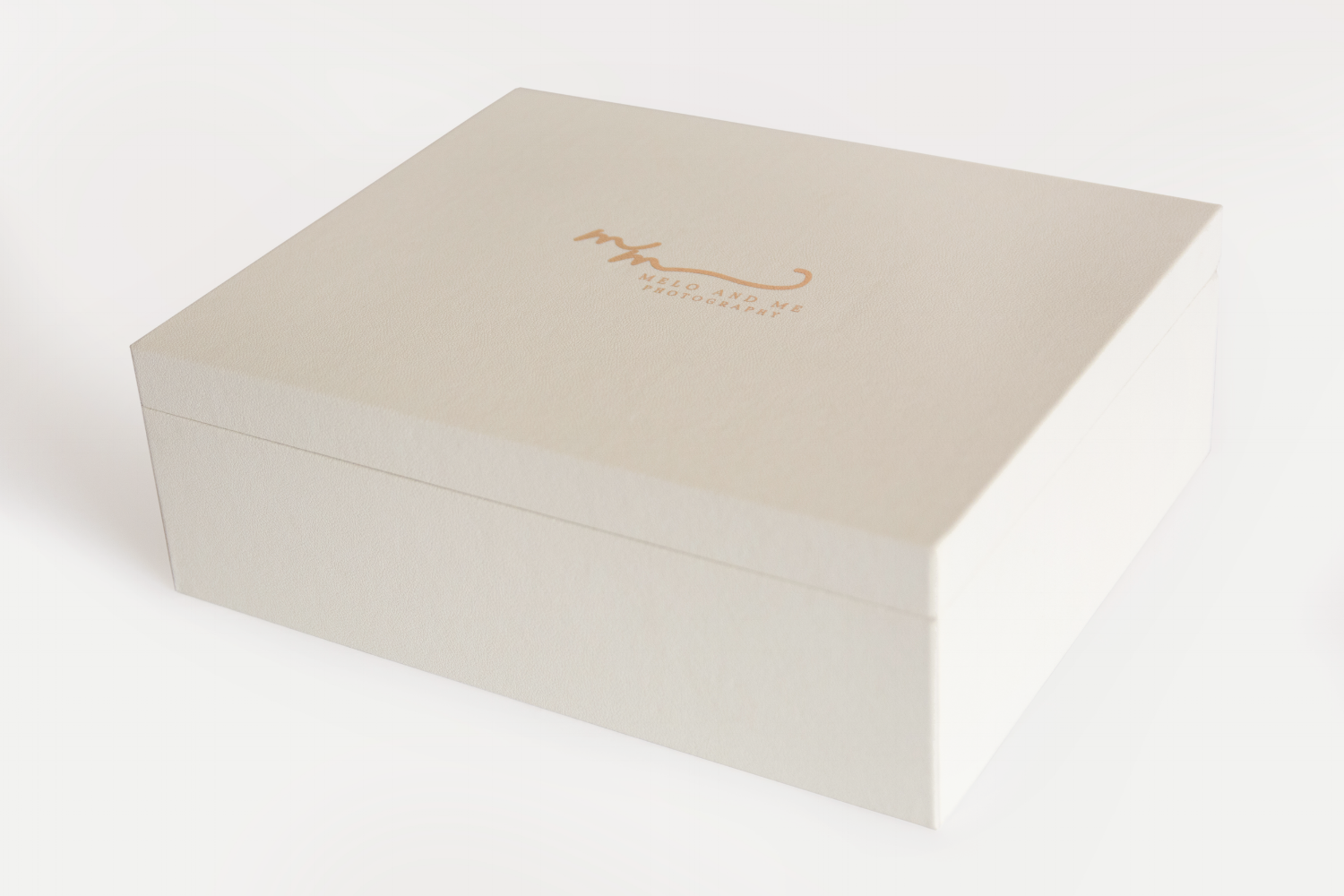 Creme colored premium box of matted prints. The perfect coffee table item for seniors, families, and weddings.