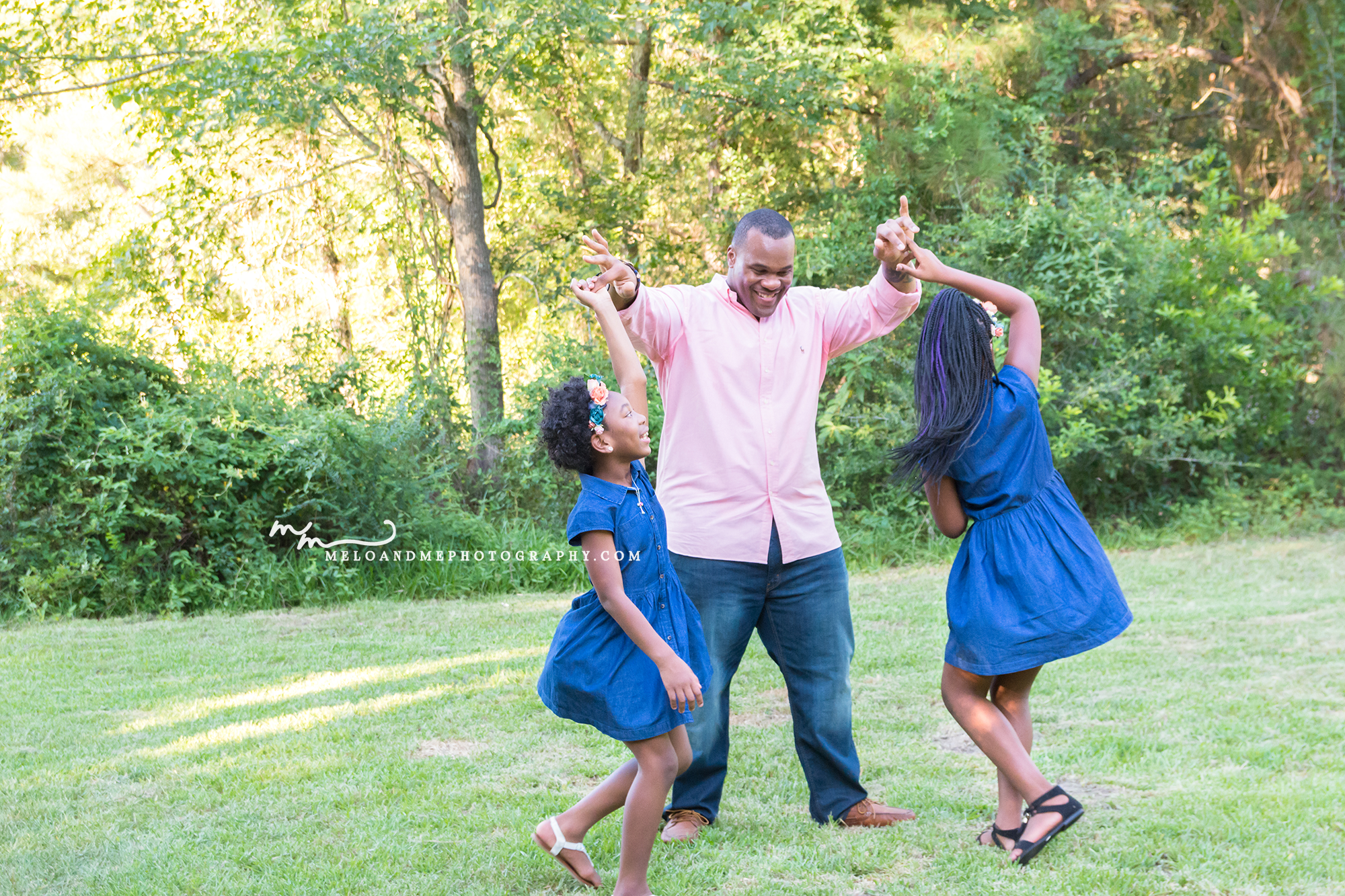 the woodlands tx family photographer black family playing at the park
