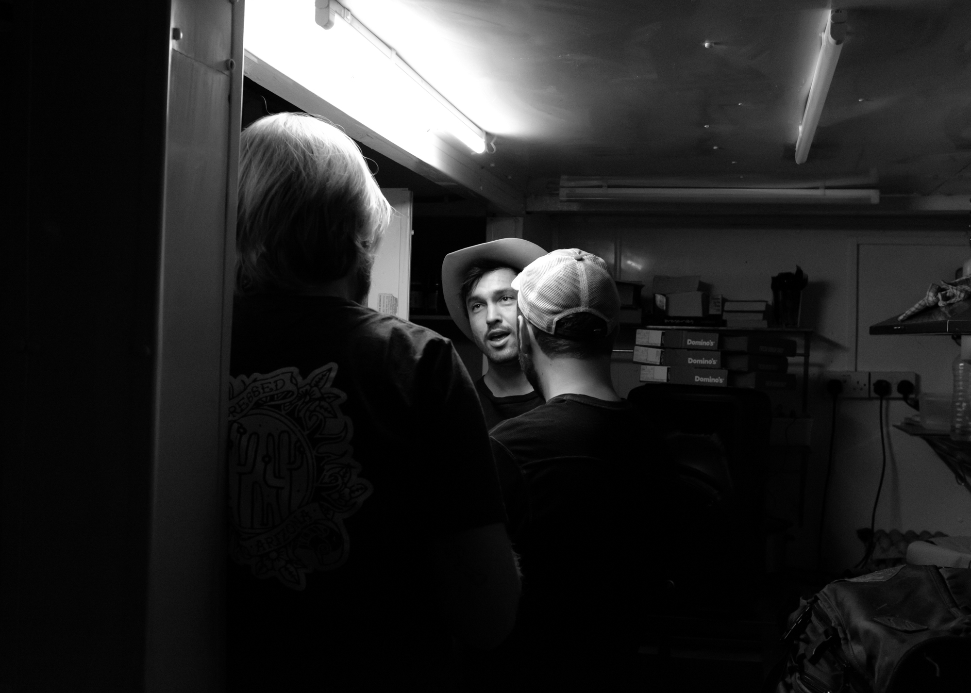 Jared, Larry, and Chuck in the kitchen/storage closet/green room. Newcastle.