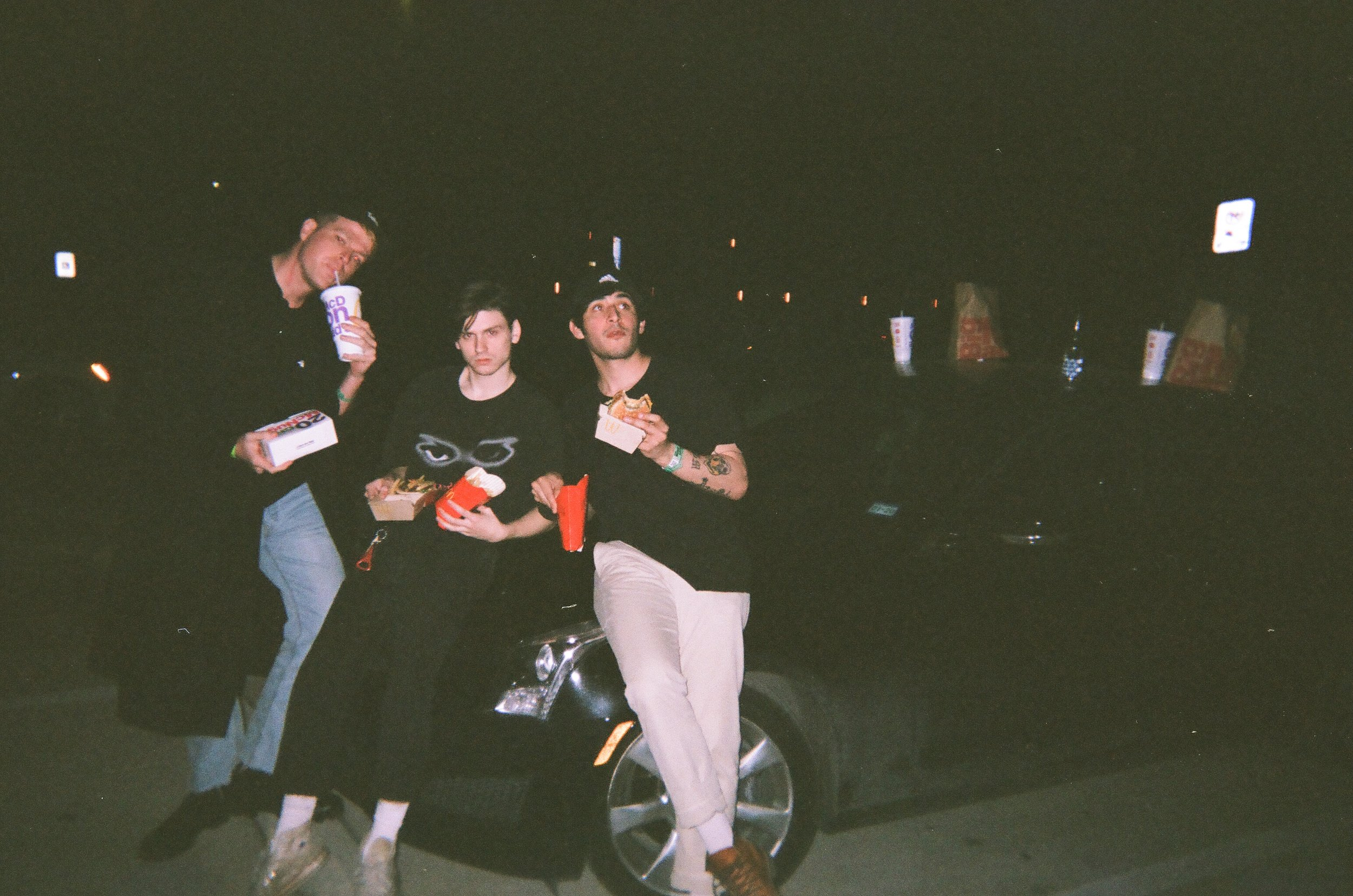 Here's a shot of us eating McDonald's at 3AM on the hood of the company car.