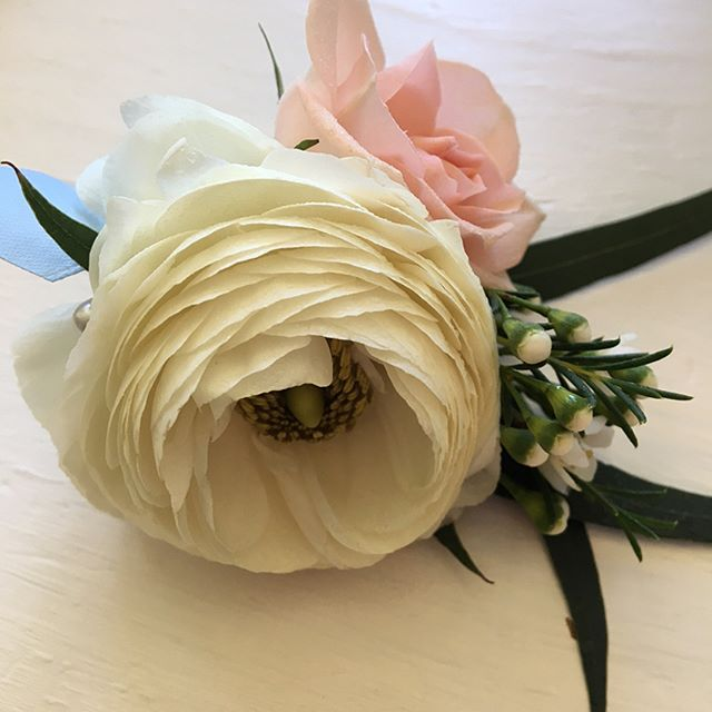 A ranunculus and rose corsage