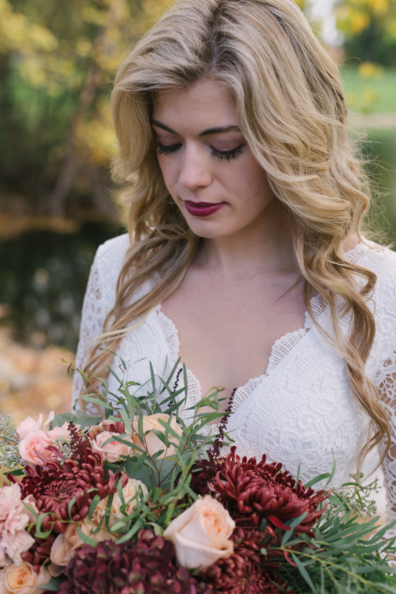 When the lips match the flowers! ON POINT! Love this makeup look for the bride. Who knew that spider mums could look so lush and rich? Love this blend of flowers and lace.