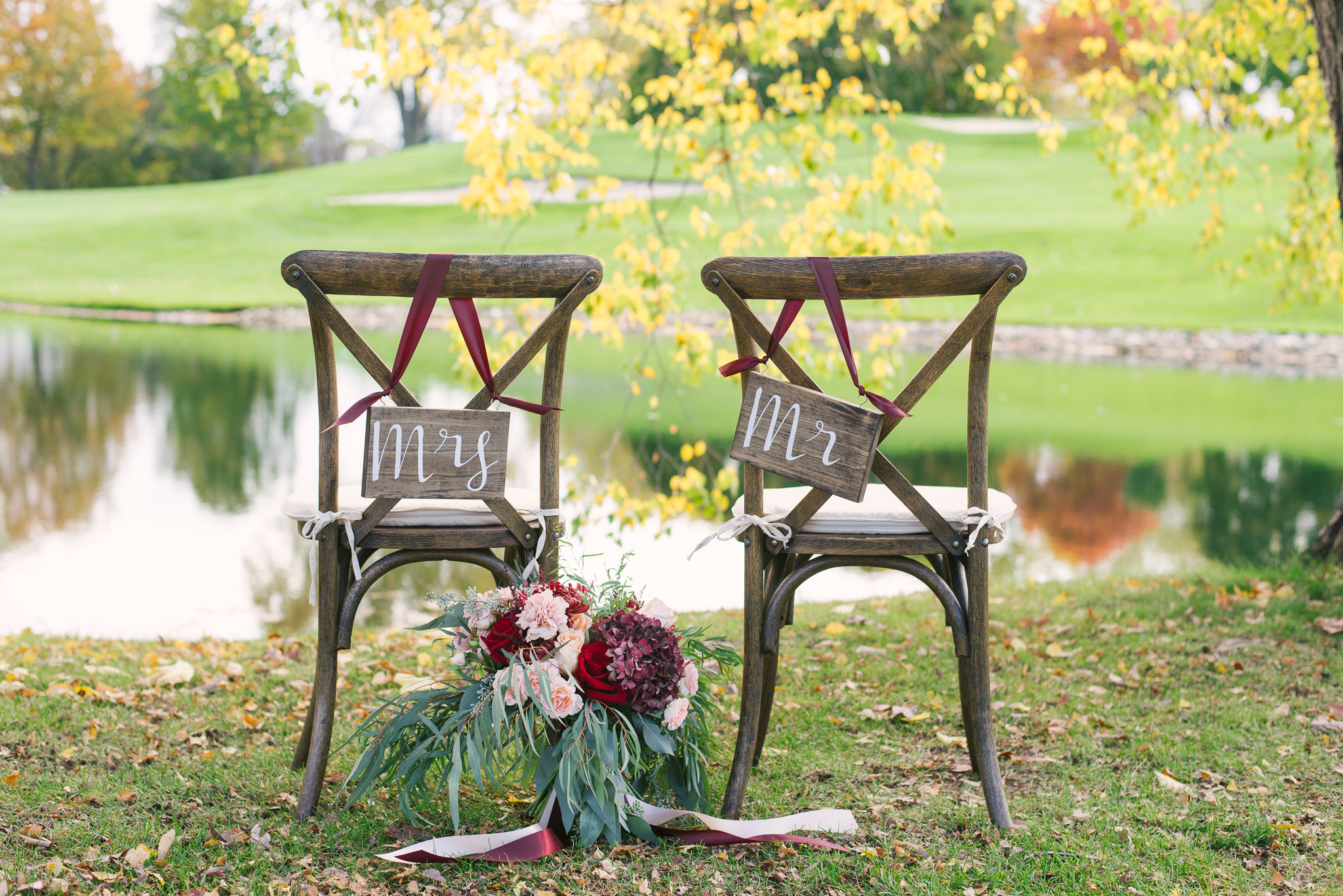 These farm chairs from  Ultimate Events  are TO DIE for! Perfect for the outdoor wedding! The signs matched perfectly, and the view, well...amazing!