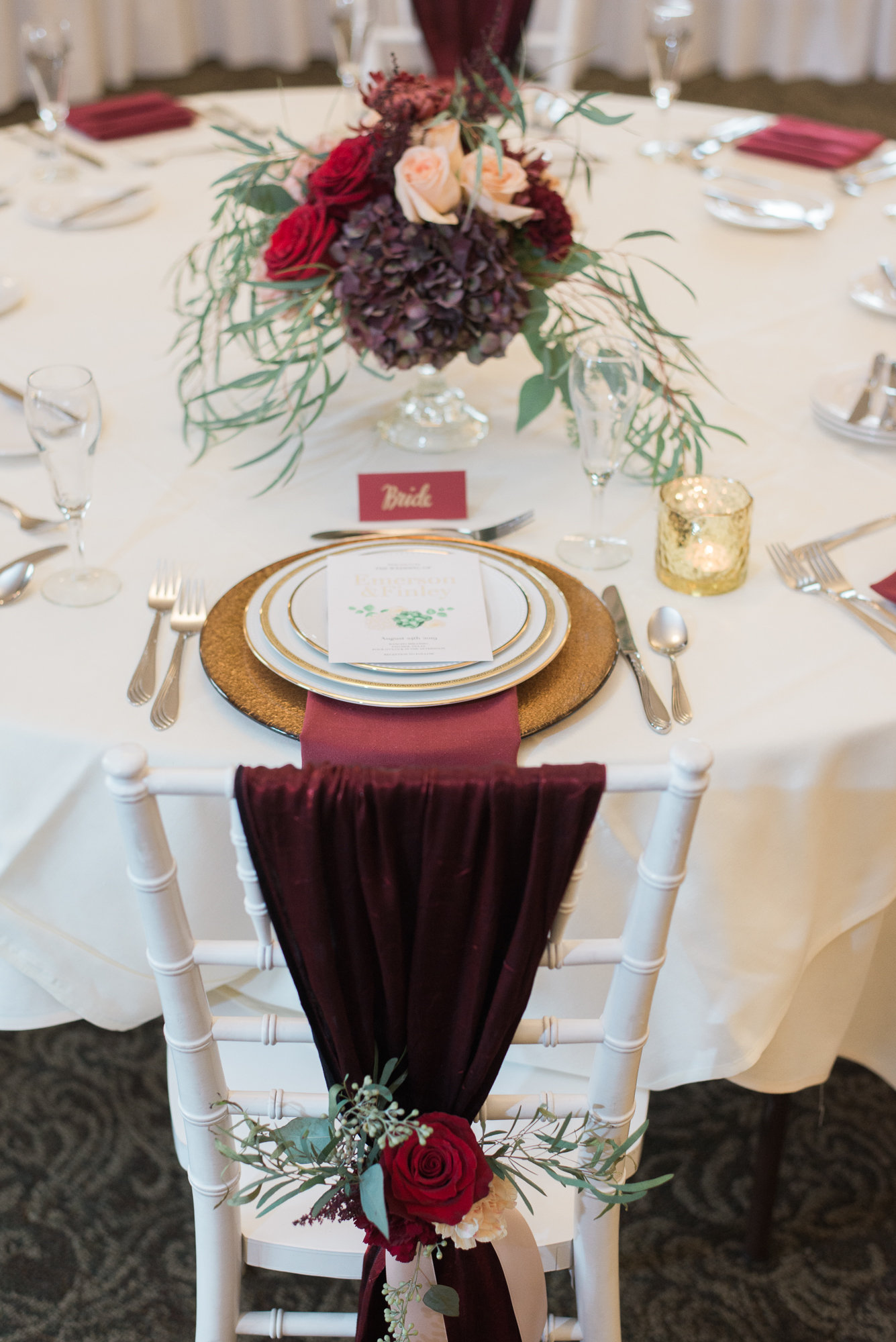 Don't forget the little details, the chairs and fabric swag from  Ultimate Events  were the perfect compliment to the table setting and flowers!
