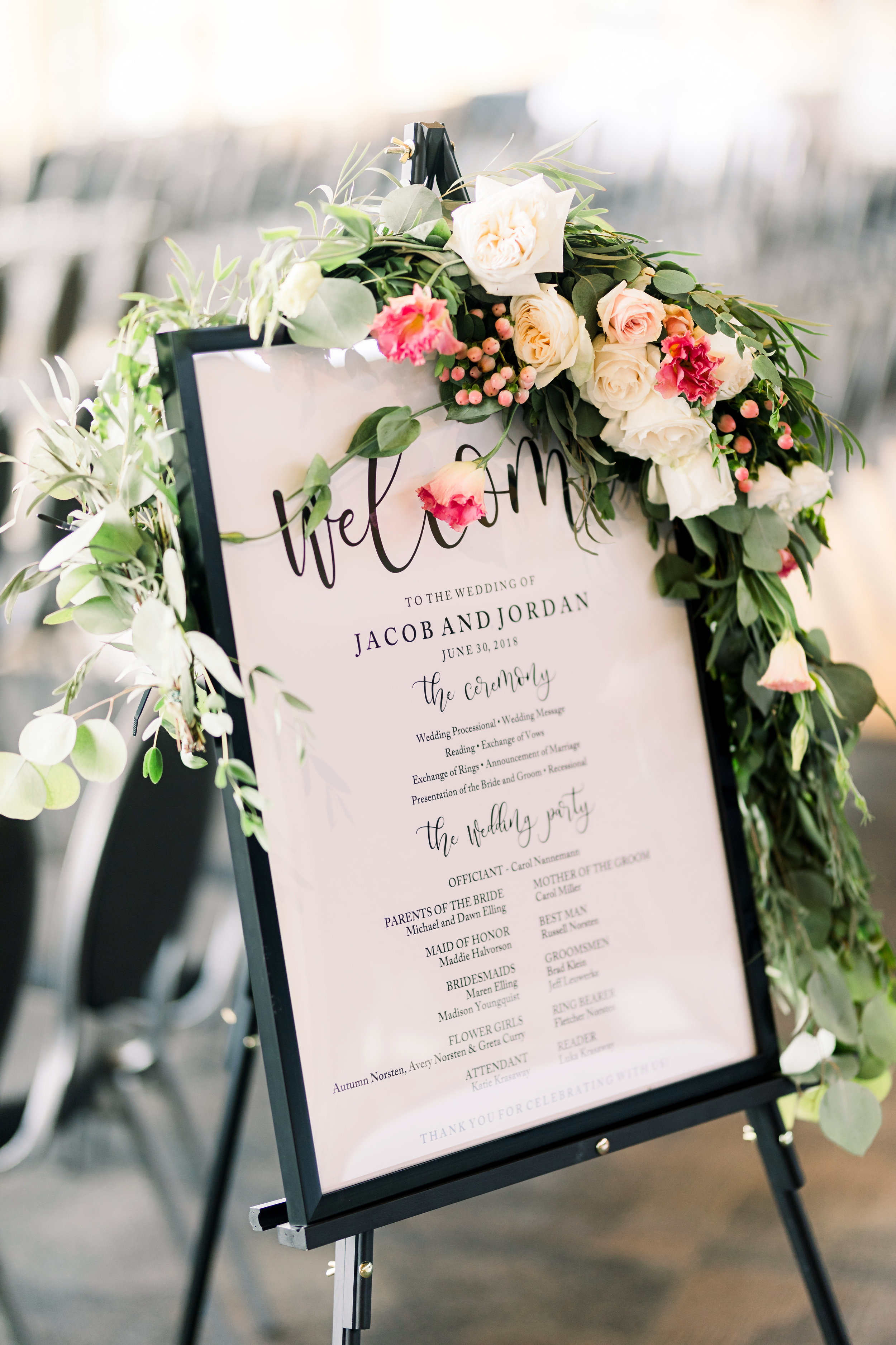 What a nice way to greet your guests and save on paper! The program is a sign! and when you decorate it with garland and flowers it is a piece of art!