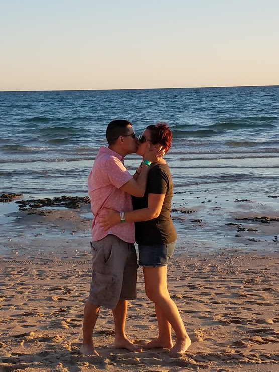Post-surgery in 2017 but very sick with Hashimoto's - Kissing my hubby on the beach at our Family getaway spot in Mexico. We are taking this life one day at a time, and trying to find joy in every moment.