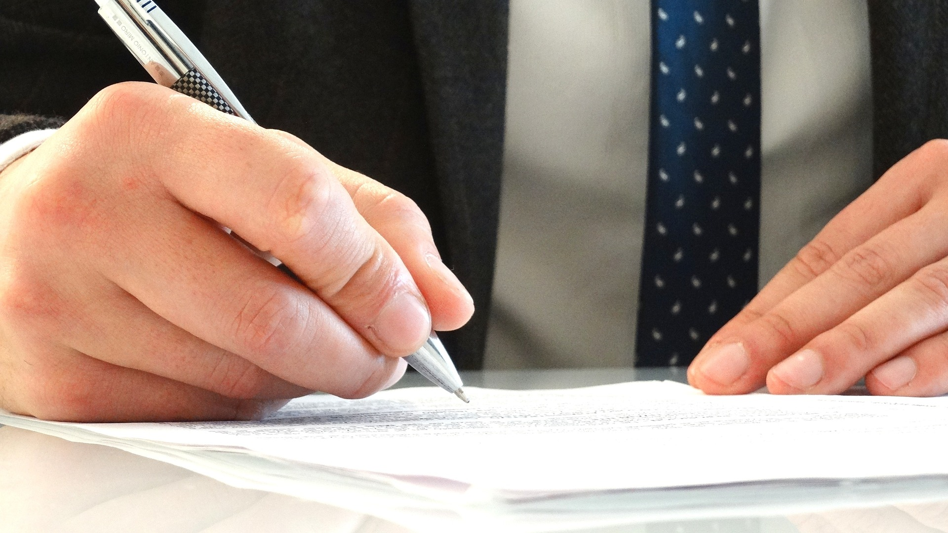 Lawyer drafting legal documents providing additional legal services