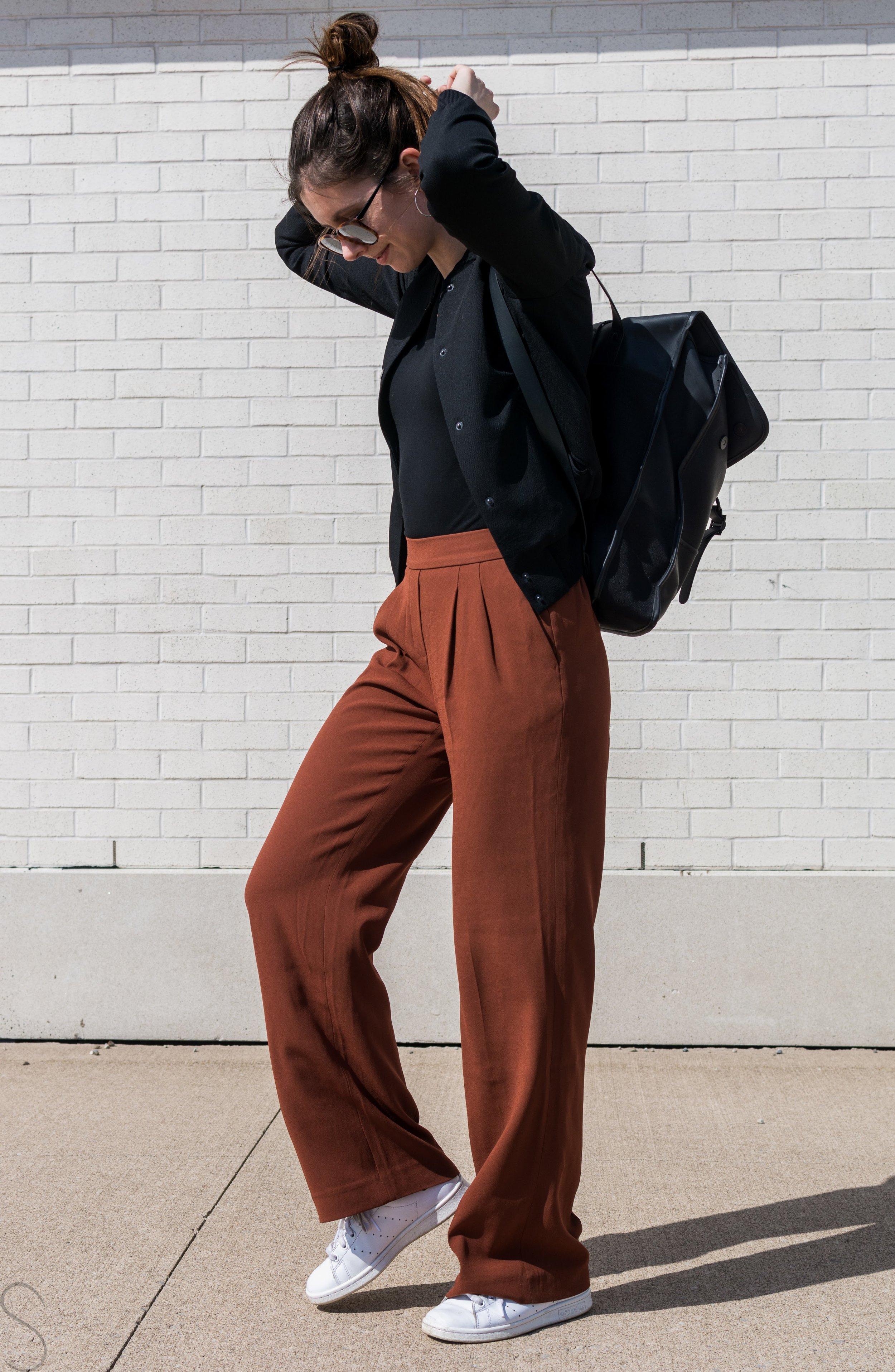 rust wide legged pants artizia rains commuter bag