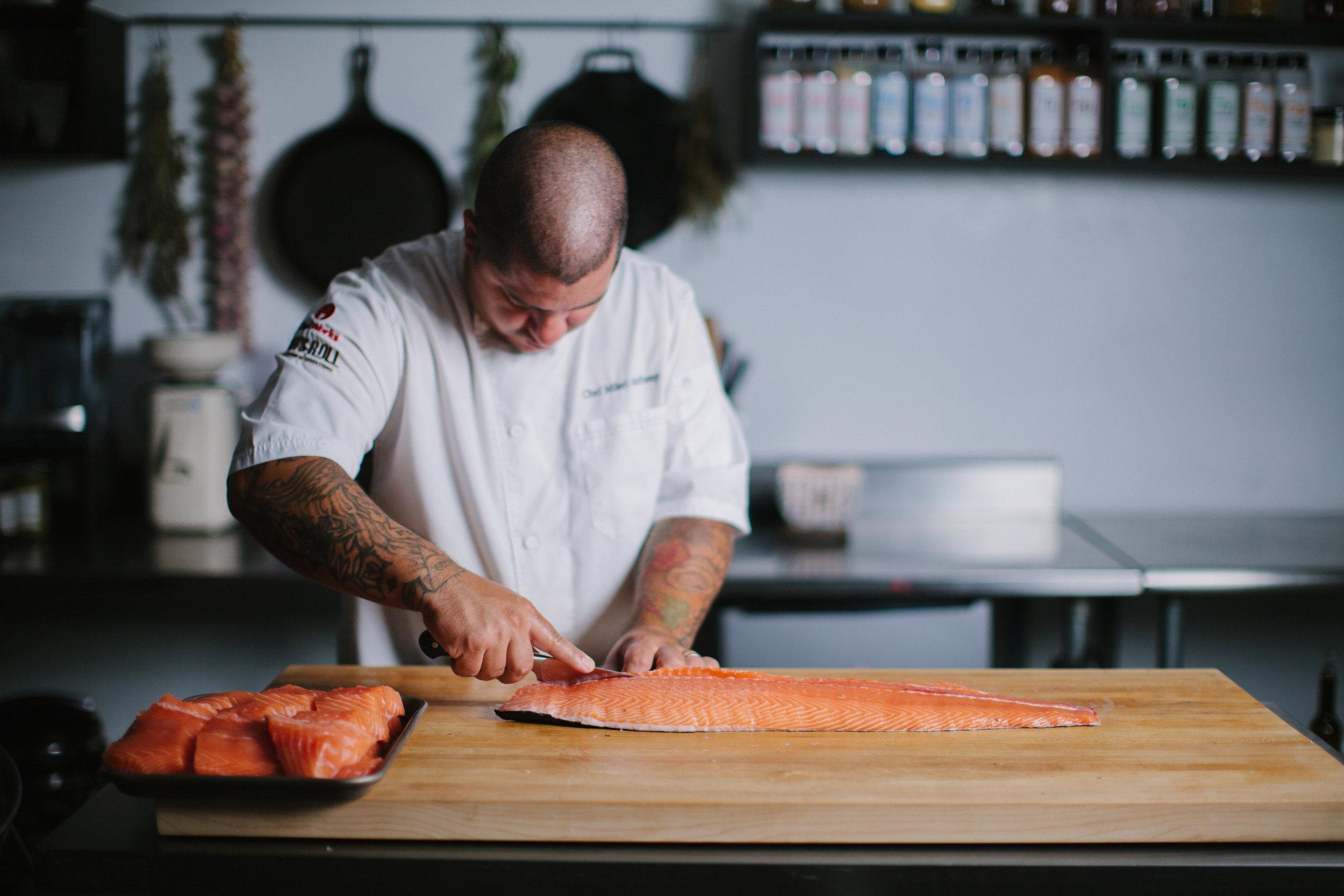 Chef working with Verlasso salmon