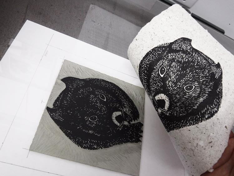 Pulling a lino print onto handmade paper. Lino is a type of relief printing.