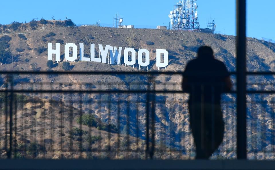 Hollywood and the music industry have traditionally controlled access and distribution. (Credit: FREDERIC J. BROWN/AFP/Getty Images)