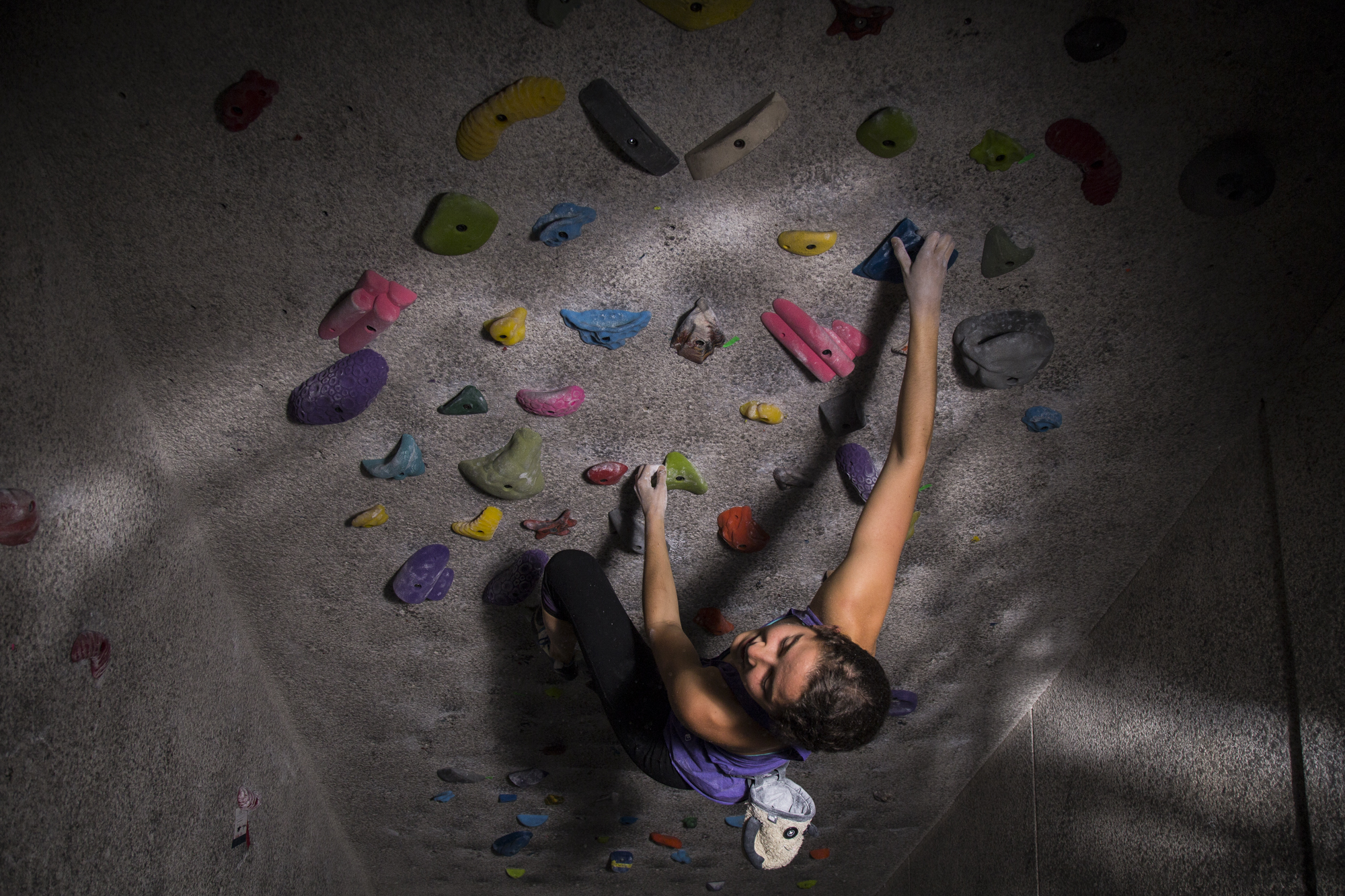 Kerry Scott, the president of Carolina Climbing Club, boulders at the Student Recreation Center in Chapel Hill, N.C., on Oct. 18, 2016. Hear her talk about climbing below: