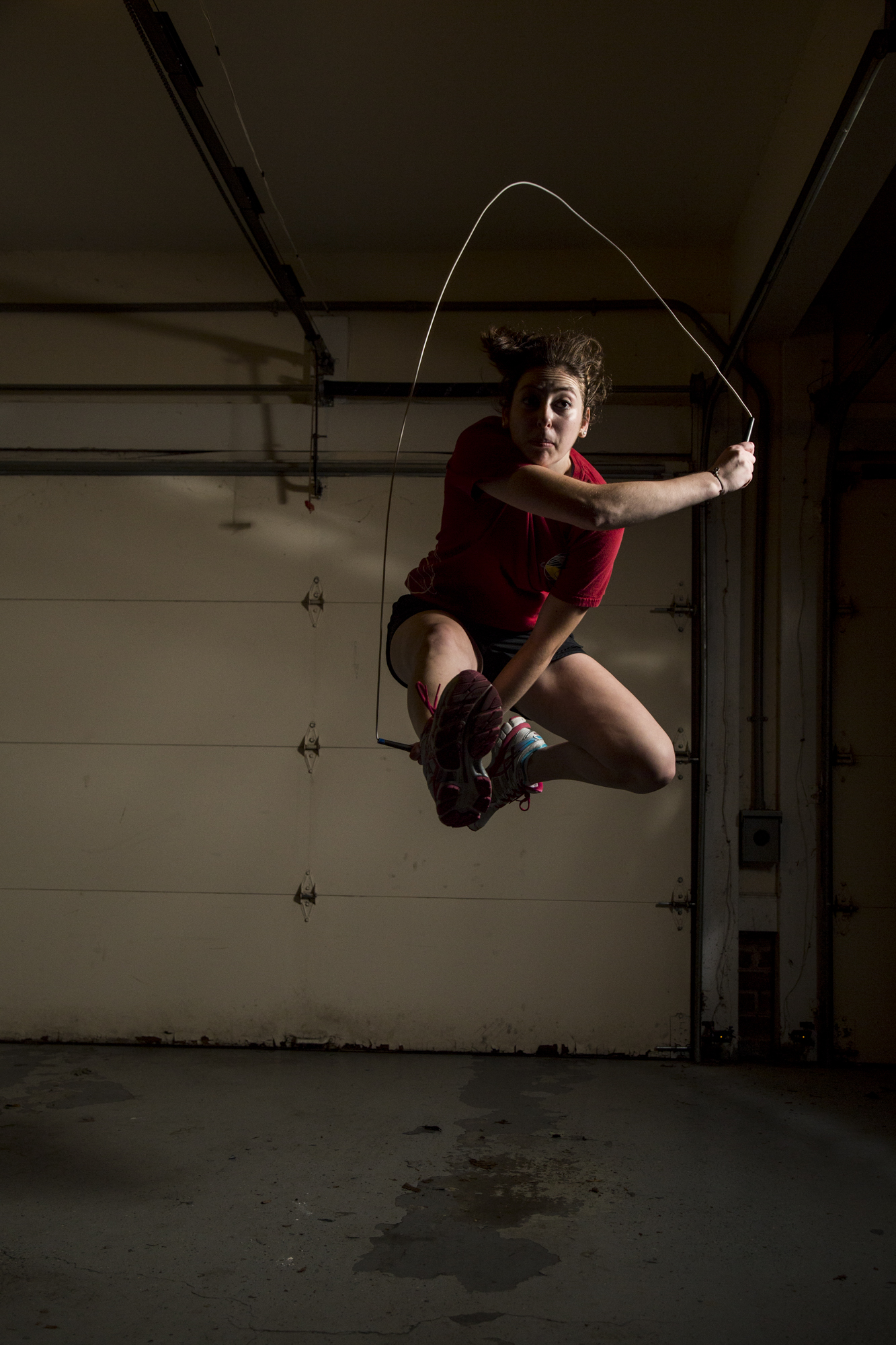 Rebeccah Musson, a senior at East Chapel Hill High School and a jumper in the Bouncing Bulldogs, jumps rope in her garage in Chapel Hill, N.C., on Oct. 17, 2016.   Hear her talk about jump-roping below: