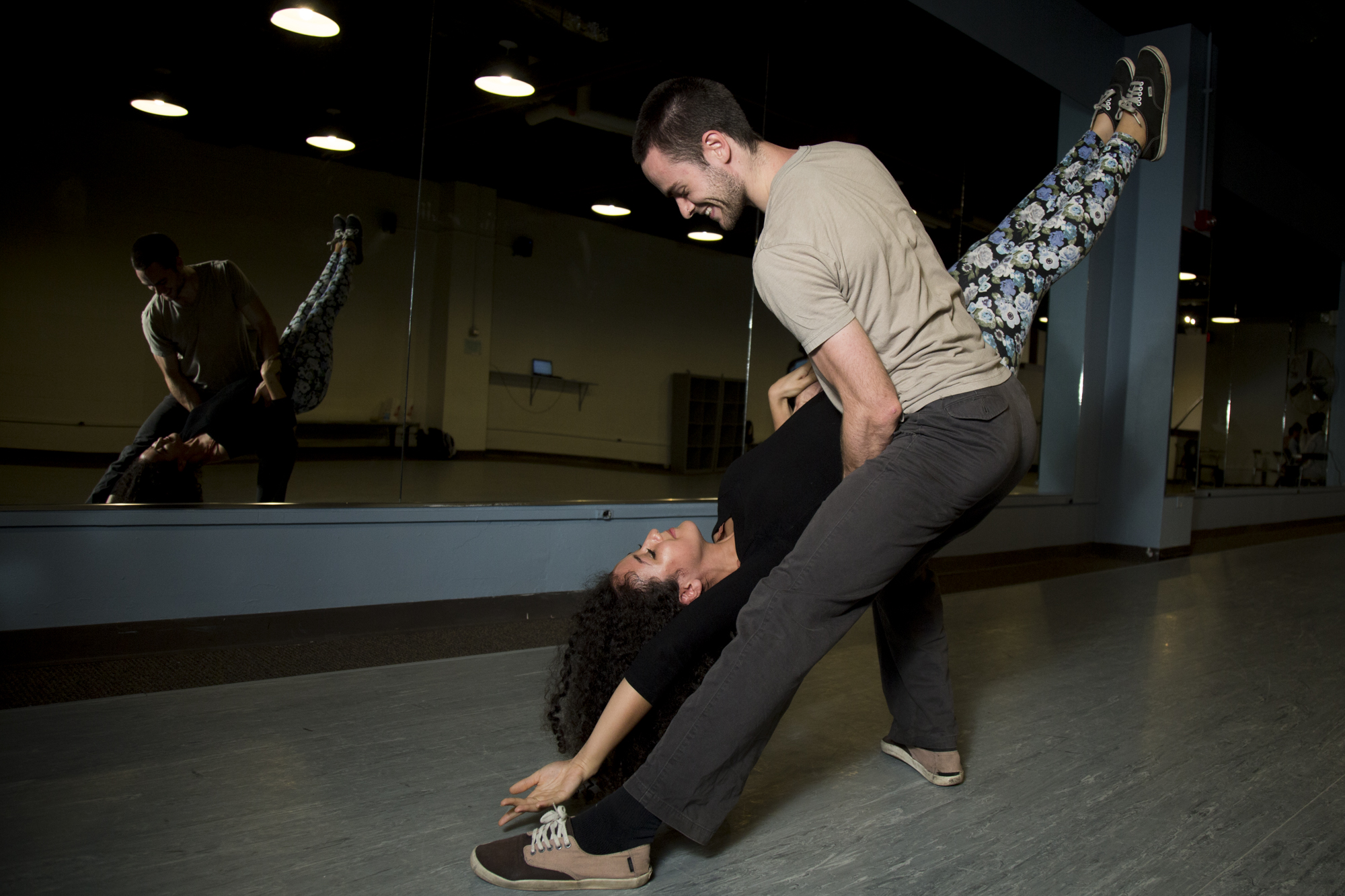 Khaleelah Elhajoui (left), a senior at UNC, fusion dances with Ansel Dow in the Student Union in Chapel Hill, N.C., on Oct. 14, 2016. Hear her talk about dancing below: