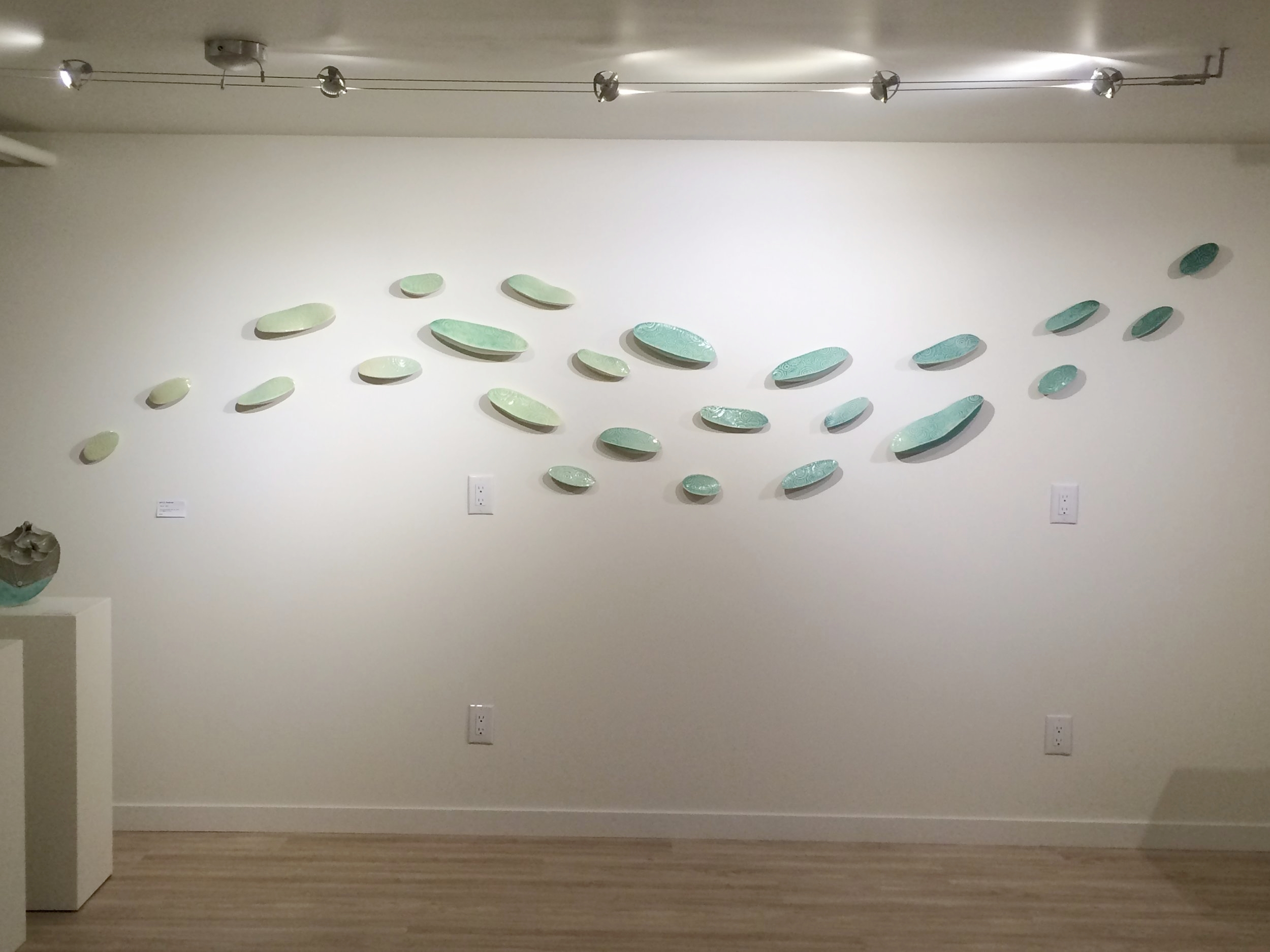 "Julie Anderson's ""Ripple"" porcelain wall installation at the Warehome Gallery"