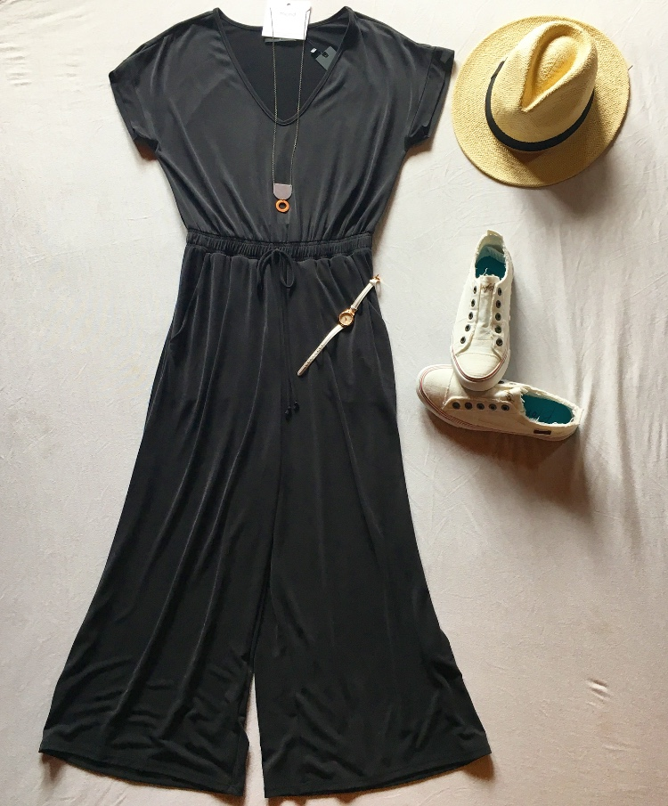 The jumpsuit itself, which is by COA, sells for $99. It's the perfect outfit for any height since the legs are cropped. And another bonus: it's really soft and comfy. Pair it with the Blowfish Malibu White Sneakers, which are available at Venue for $39. Complete the look with the Lucky Hat for $59.50 and the Mend on the Move Necklace for $32.