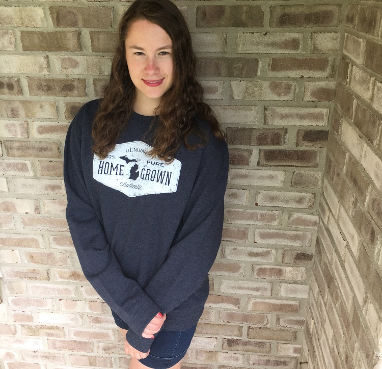 If you want to be this cozy, grab the Livnfresh Home Grown Sweatshirt at Venue for $50.