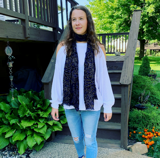 If you want to channel your inner Olivia, you can grab the Free People Chill Out White Top for $68 and pair it with the Sneak Peak Mid Rise Light Jeans for $49. Add any dark-colored scarf you have, and you'll be set!