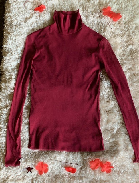 A lightweight turtleneck = genius. You can buy the Free People Mesh Long Sleeve Turtleneck for $48.